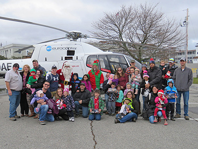 Coast Guard families with Flying Santa